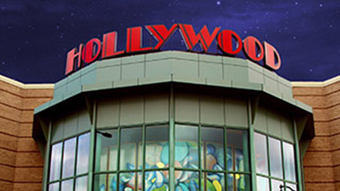 The Hollywood property sign sits above a window showing a mural at Hollywood Casino in Bangor, Maine.
