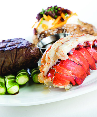 plate of steak and lobster tail on white background