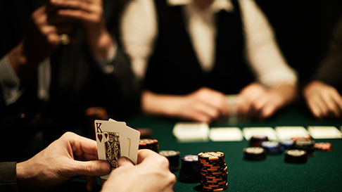 table games image man holding cards