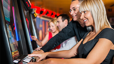 Woman enjoying herself playing slots